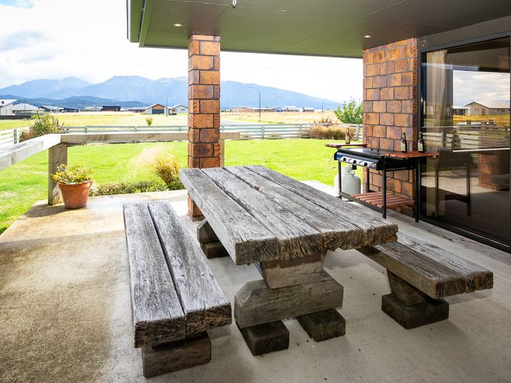 Lrge outdoor dining and BBQ area with a view