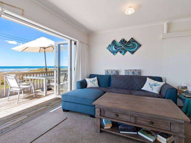 Living area opens out to the decking and views!