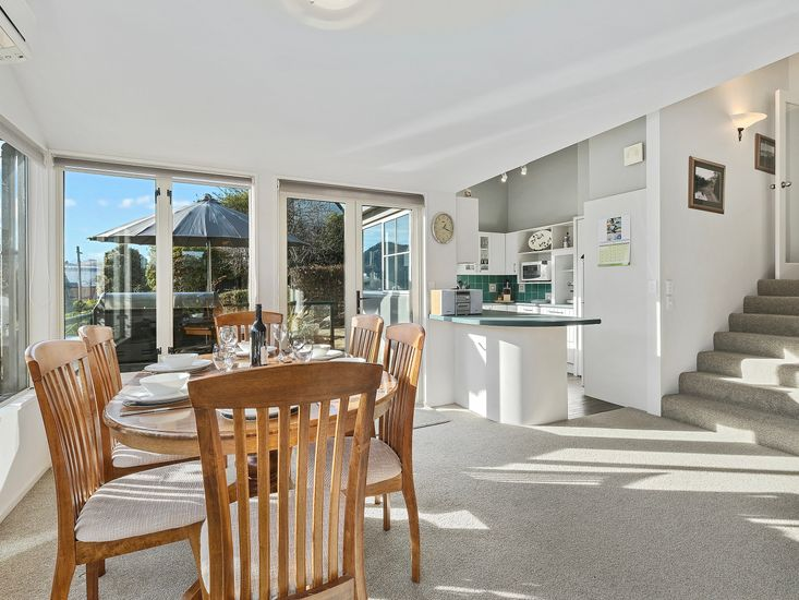 Dining table onto outdoor dining area and kitchen
