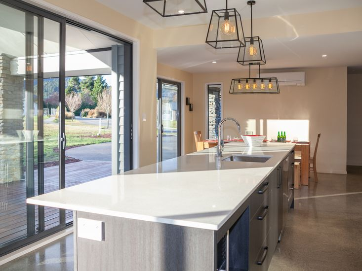 Kitchen and breakfast bar onto dining area and sundeck