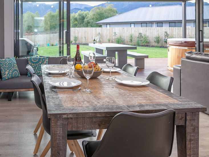 Dining table onto living area and outdoor area