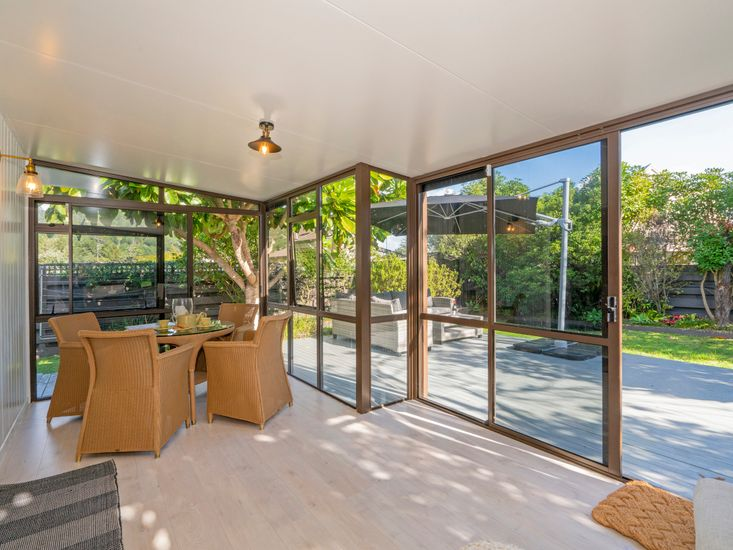 Sunroom opens out to the garden and decking