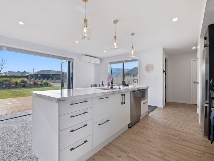 Open plan living, dining and kitchen area opens out to the sundeck
