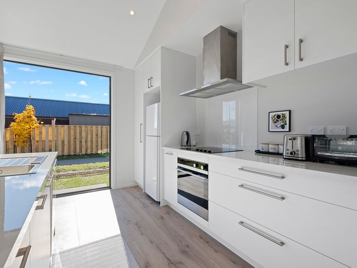 Modern kitchen opens out to the garden