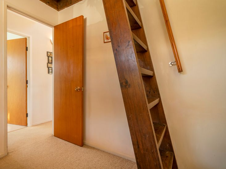 Ladder access to mezzanine level in bedroom 2