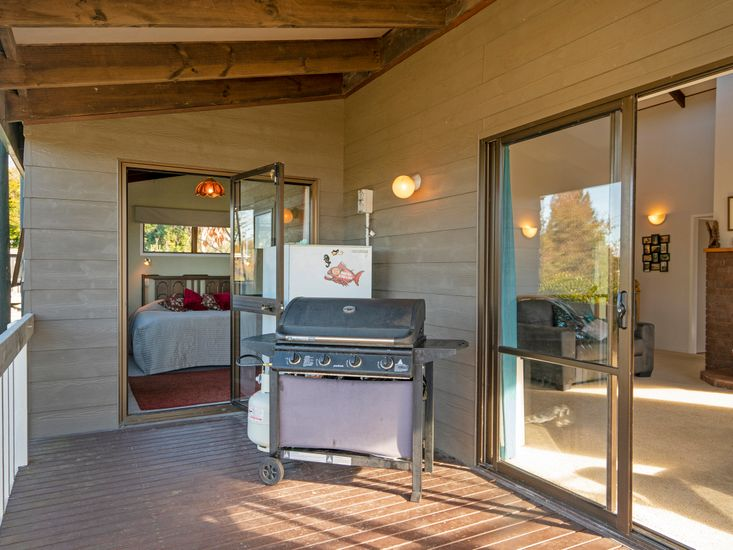 Sheltered BBQ area on the sundeck - onto master bedroom
