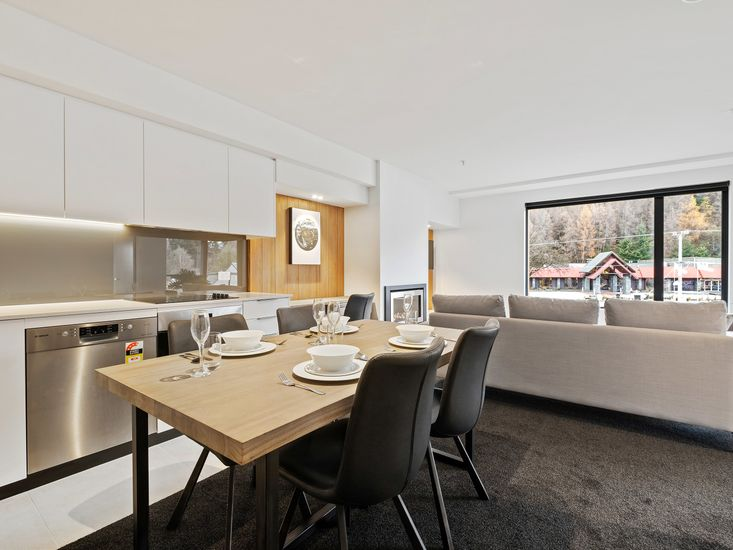 Dining table onto kitchen and lounge area