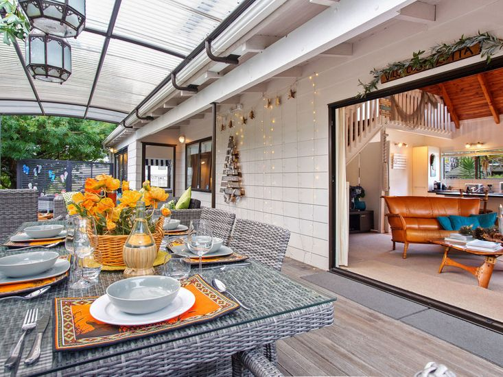 Sheltered outdoor dining and living on the deck