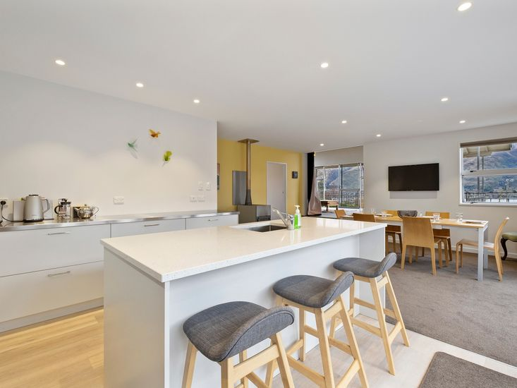 Kitchen and breakfast bar onto dining area