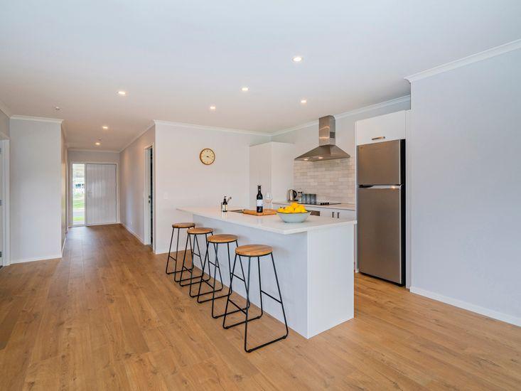 Large modern kitchen with breakfast bar