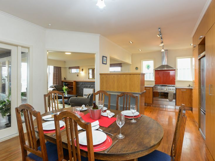 Dining table onto kitchen and lounge