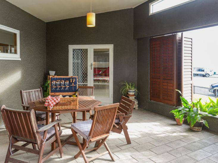 Sheltered outdoor dining area onto master bedroom
