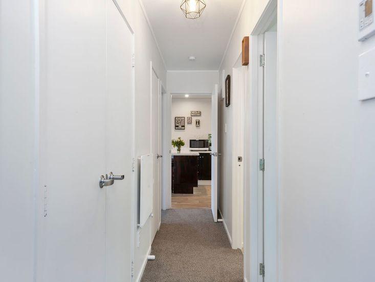 Hallway onto bedrooms and bathroom