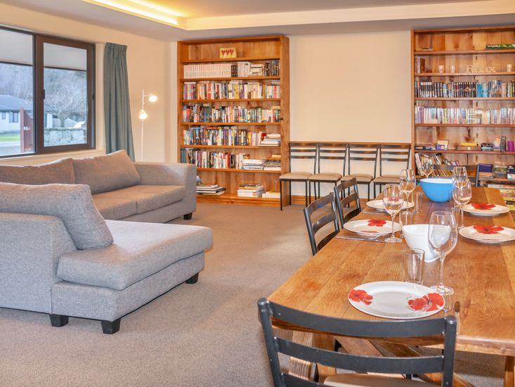 Dining table onto sitting area and library
