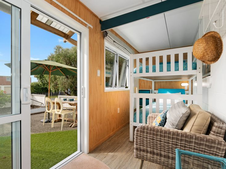 Front entrance and sunroom with bunk beds