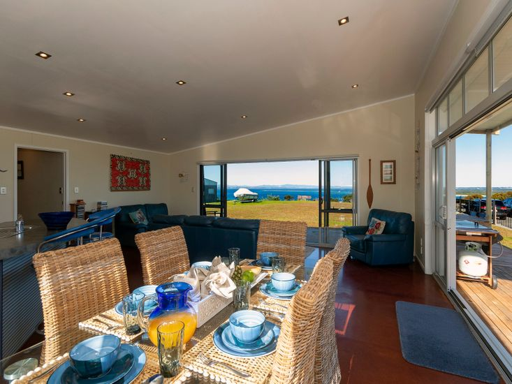 Open plan dining, lounge and kitchen out onto the views