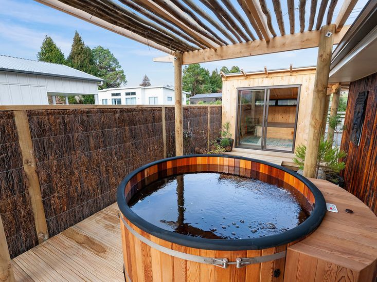 Cedar spa pool in the landscaped garden and outdoor area