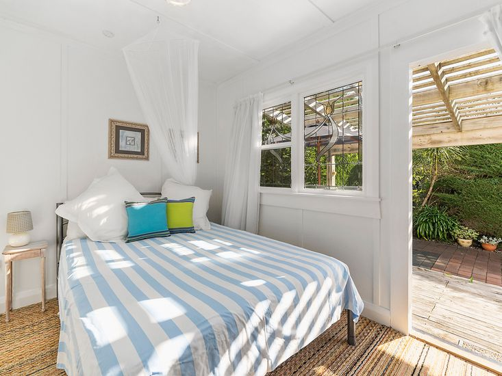 Master bedroom opens out to sundeck and garden