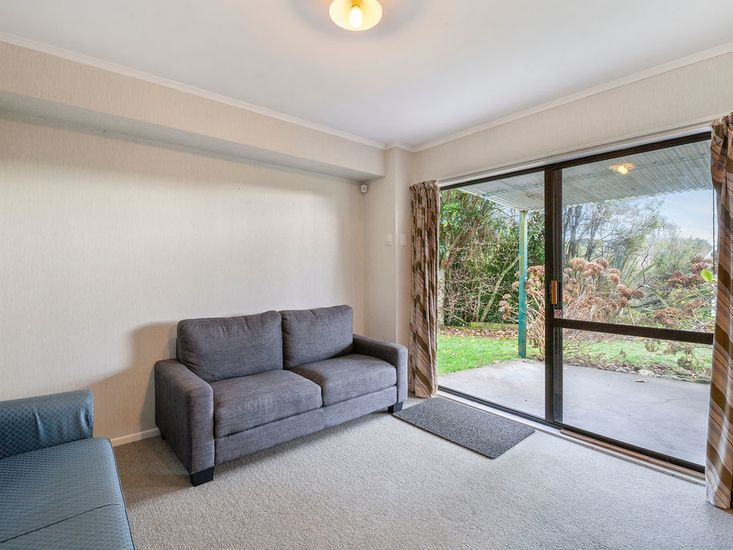 Downstairs lounge and access to garden