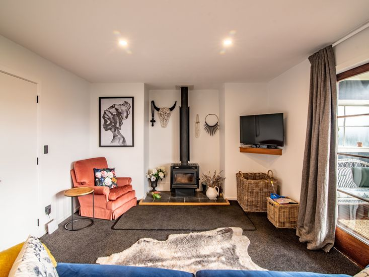 Comfy lounge area around fireplace