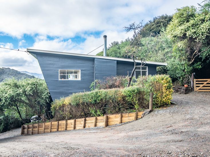 Exterior, steep driveway and parking space