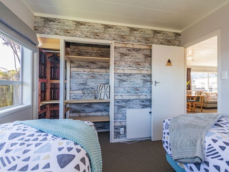Rustic styled wall in bedroom three