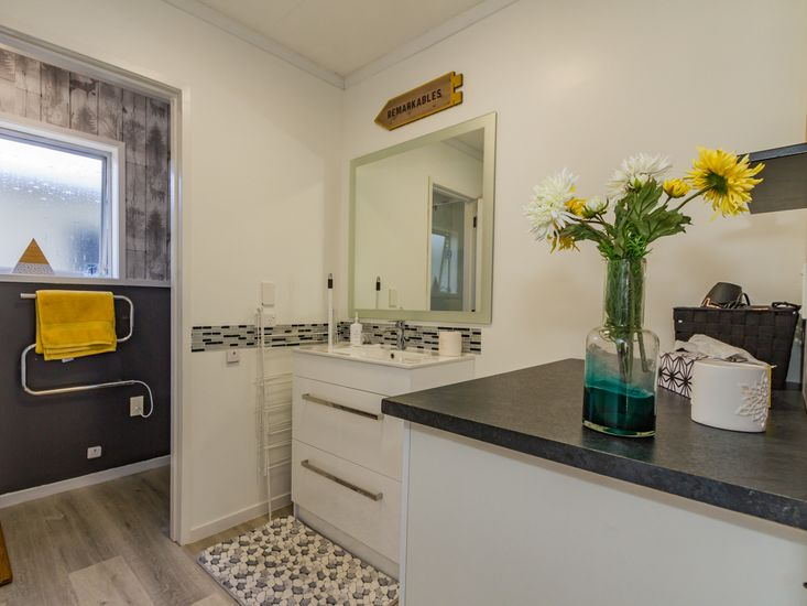 Bathroom view of cabinets and sink