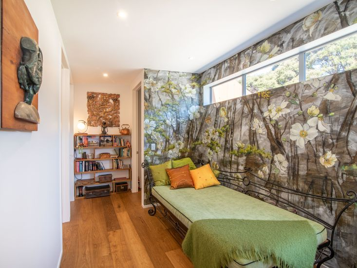 Hand painted mural and day bed - the perfect spot to read!