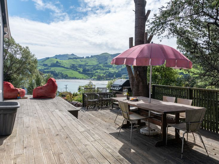 Outdoor living and dining area with a view