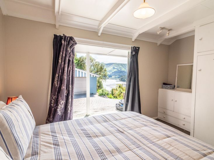Master bedroom opens out onto the sundeck and views
