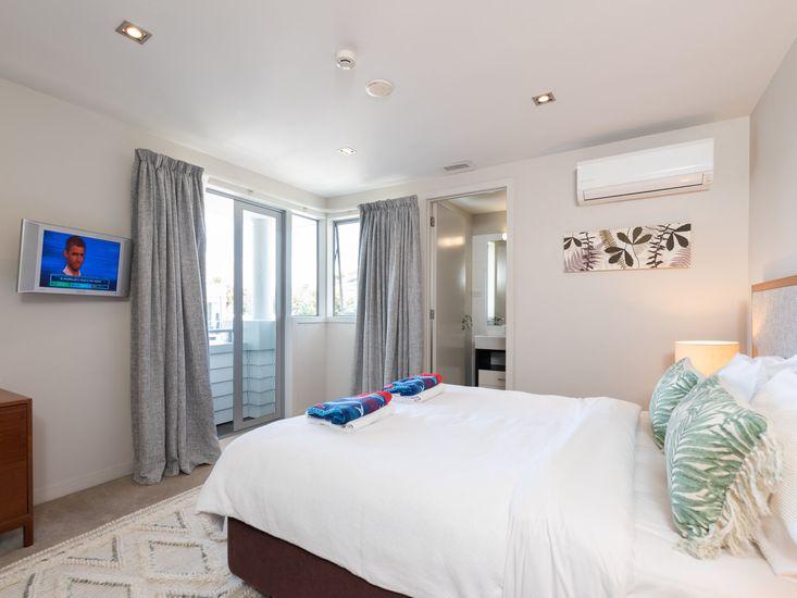Master bedroom onto small balcony