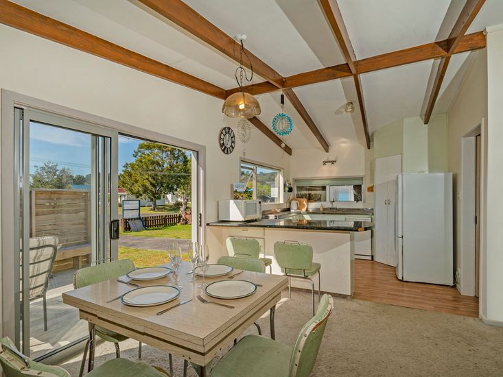 Living and dining area opens out to the sundeck