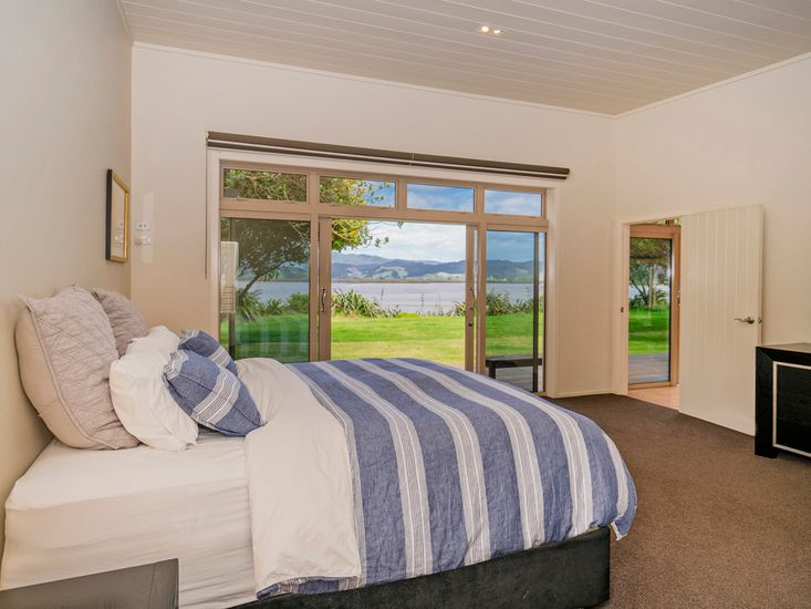 Master bedroom with access to sundeck and waterfront